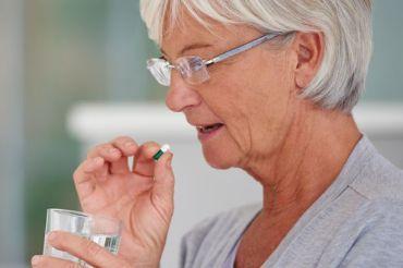 Senior-woman-about-to-take-a-pill